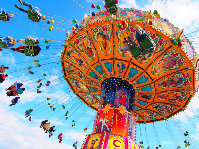 have fun Amusement Park Amusement Park Ride Arts Culture And Entertainment Carousel Day Enjoyment Large Group Of People Leisure Activity Low Angle View Outdoors People Real People Sky Paint The Town Yellow