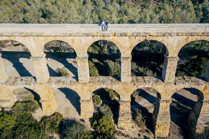 Aqueduct DJI X Eyeem Drone  The Ferreres Aqueduct Adult Aerial Aerial View Animal Themes Arch Architecture Bridge Bridge - Man Made Structure Built Structure Day Dronephotography Full Length History Nature Old One Man Only One Person Only Men Outdoors People Real People Tree Press For Progress