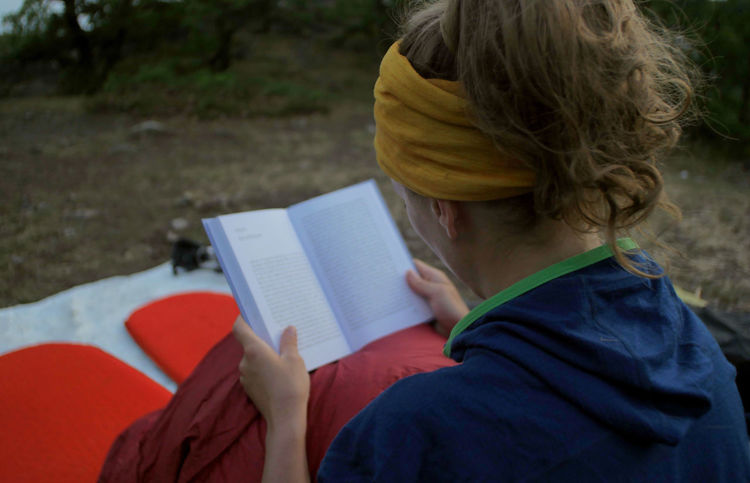 young caucasian female reading book while outdoor camping Backpacking Camping Hiking Nature Reading Travel Trekking Woman Activity Adult Book Caucasian Concentration Day Education Female Focus On Foreground Girl Hair Hairstyle Headshot Hikingadventures Hobby Holding Learning Leisure Activity Lifestyles One Person Outdoors Paper People person Publication Reading Real People Relaxation Sitting Studying Tent Vacation Women