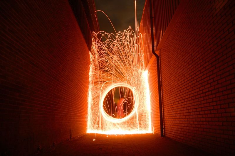 Illuminated Light Painting In Alley At Night