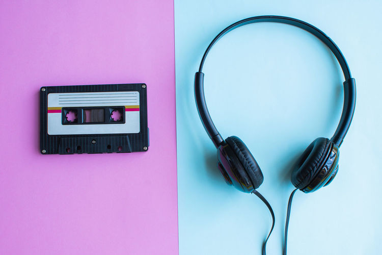 Tape Cassette Retro Old Vintage Technology Connection Indoors  Cable Communication Electricity  Close-up No People Telephone Pink Color Still Life Colored Background Table Headphones Listening Blue Music Wireless Technology Arts Culture And Entertainment Telecommunications Equipment Electrical Equipment Outlet Power Supply Purple