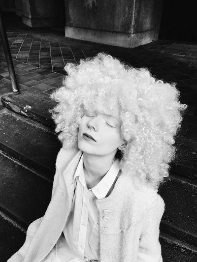 Portrait Of A Woman Wearing Wig