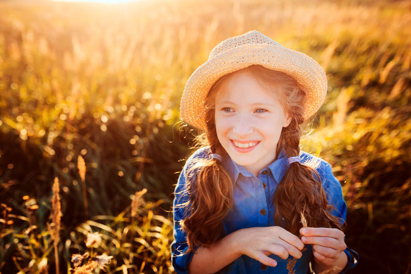 Portrait of smiling girl on field