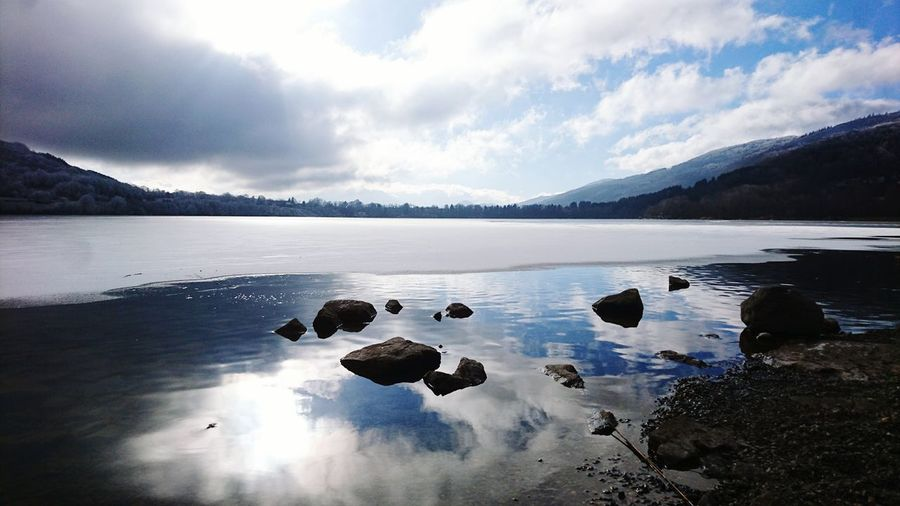 Lake Reflection Landscape Ice Water Beauty In Nature Nature No People Outdoors Extreme Weather Flying Rock Sky And Clouds Sky Dramatic Sky Landscape Day Beauty In Nature Dramatic Sky Iced Lake Winter Cold Sun Reflection Water Surface Peace And Quiet Where Is The Sky? Cold Temperature
