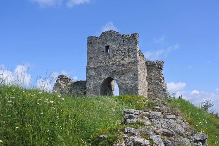 Low Angle View Of Old Ruin On Hill Against Blue Sky
