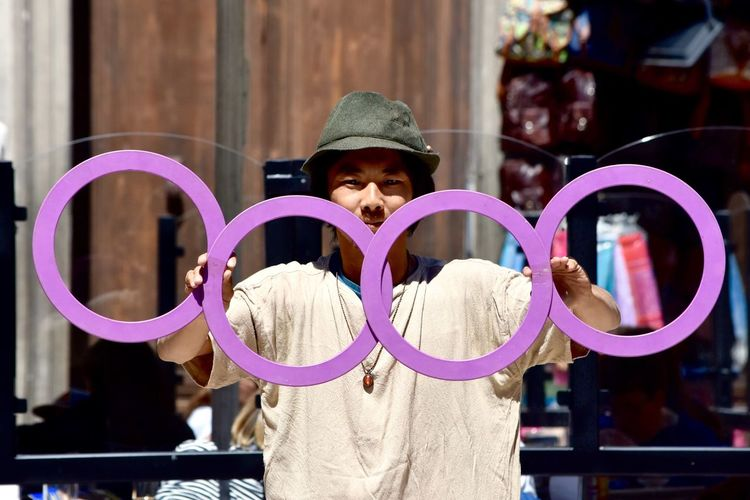 Portrait Of Juggler Performing With Rings