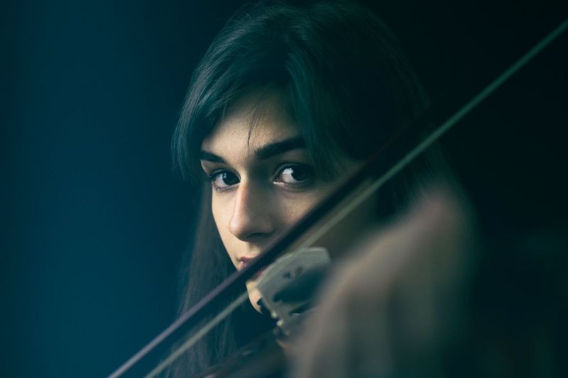 Portrait of woman with violin