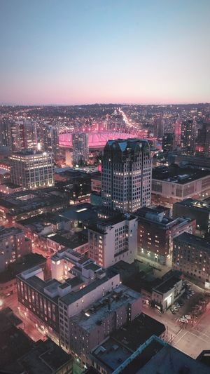High Angle View Of Illuminated City Buildings Against Clear Sky