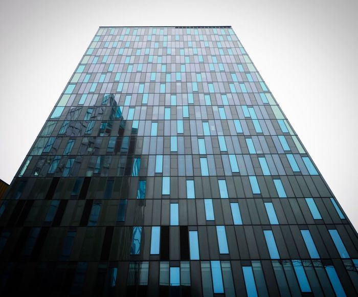 City Architecture Building Exterior Built Structure Reflection Gray Low Angle View Clear Sky Modern Skyscraper No People Sky Outdoors Day Office Block