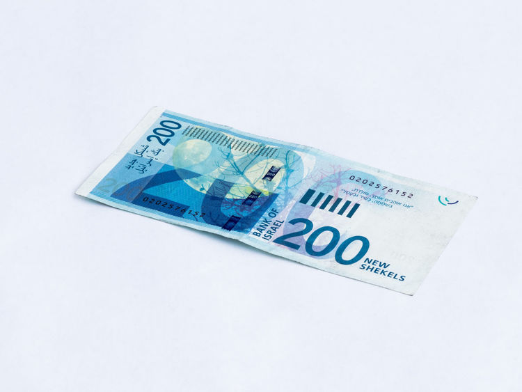 A new type of banknote worth 200 Israeli shekels isolated on a white background Wealth Banknotes Business Currency Economy Foreign Rich Bank Banknote Cash Close-up Commerce Credit Debt Economic Finance Investment Israel Money Paper Pay Profit Saving Shekel White Background