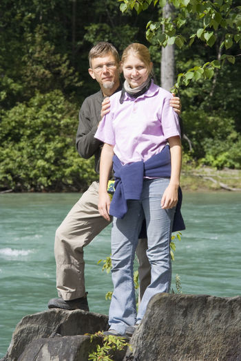 Father and daughter on Fraser River - Rearguard Falls Provincial Park, Canadian Rockies, British Columbia Adults Only Daughter Family Family❤ Father Father And Daughter Fatherhood Moments Front View Full Length Generations Happy Looking At Camera Love Loving Men Nature Outdoors Portrait River Rock - Object Smiling Togetherness Two People Water Young Women