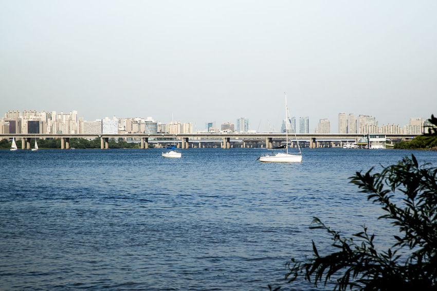 This place is the riverside of Han River. I took the photos around Dangsan Railroad Bridge. Boat Boats Bridge Bridge - Man Made Structure City Life Connection Dangsan Development Distant Engineering Korea Lake Moored Nautical Vessel Outdoors Pier Rippled River Sea Seogang Bridge Seoul Transportation Water Waterfront