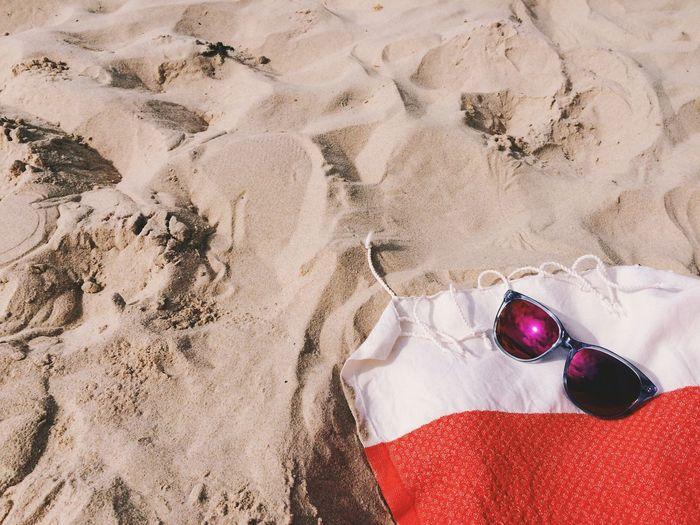 High Angle View Of Sunglasses On Towel