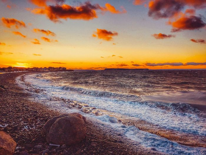 Sea Sunset Beauty In Nature Beach Water Nature Sky Wave Orange Color Shore Scenics Horizon Over Water Tranquil Scene Tranquility No People Outdoors Day