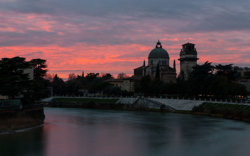 View of adige river at sunset