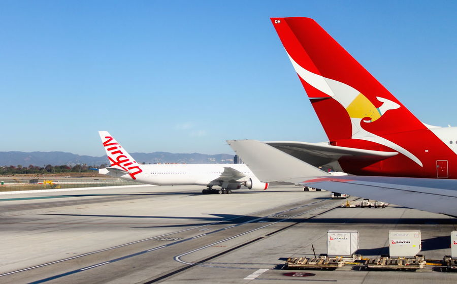 Los Angeles, USA - 25 September 2016: Aircraft sitting on the runway at Los Angeles International (LAX) Airport Holiday Los Angeles International Airport Plane Qantas Travel Air Vehicle Airplane Airport Clear Sky Day Flight Lax Airport No People Outdoors Sky Tail Tarmac Transportation