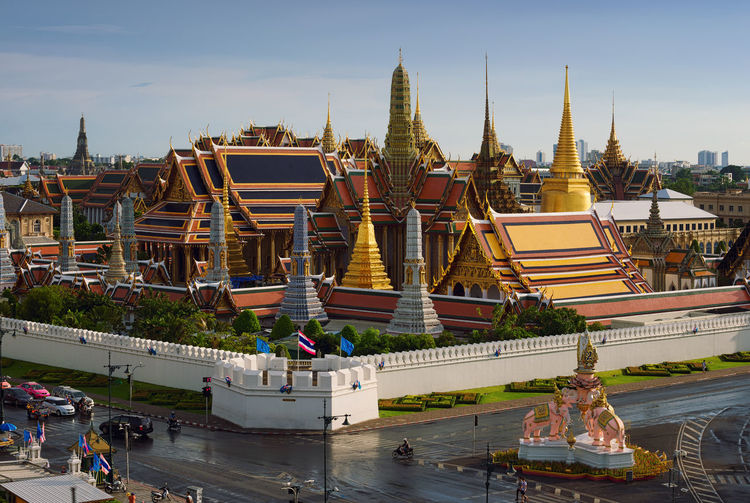 Emerald Buddha Temple, Bangkok, Thailand Architecture Bangkok Golden Grand Palace Historical Building Temple Of Emerald Buddha Thailand Architecture Building Exterior Built Structure Day Men Outdoors Palace People Place Of Worship Real People Religion Sky Spirituality Temple Travel Destinations