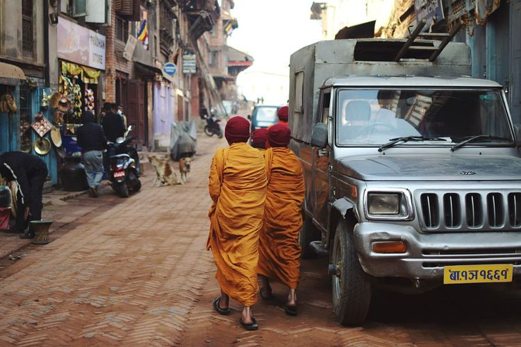 Monks in the streets. Nepal Buddhism Monks In Motion Monks Religion Tradition Mode Of Transportation Transportation Land Vehicle Motor Vehicle Car Rear View Real People City Street Men Incidental People People Full Length Road Lifestyles