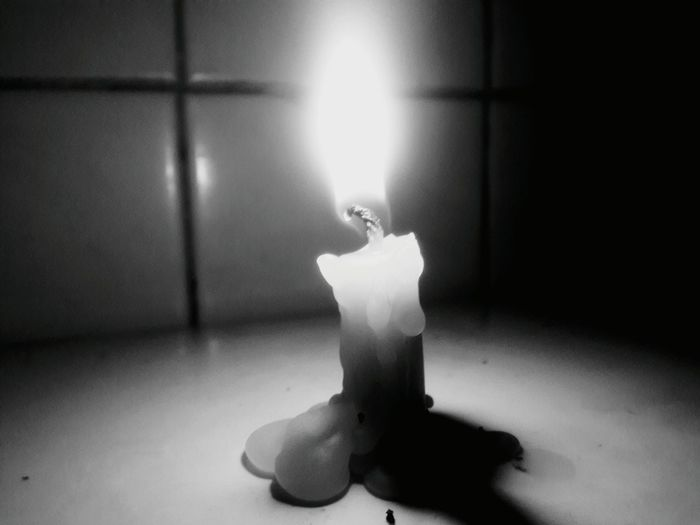 Nothing can dim the light that shines from within.. Candle Candlelight Candle Light Brownout Black And White Black & White Light Blackandwhite Photography Black&white Blackandwhite Showcase April Quotes Samsungphotography Still Life