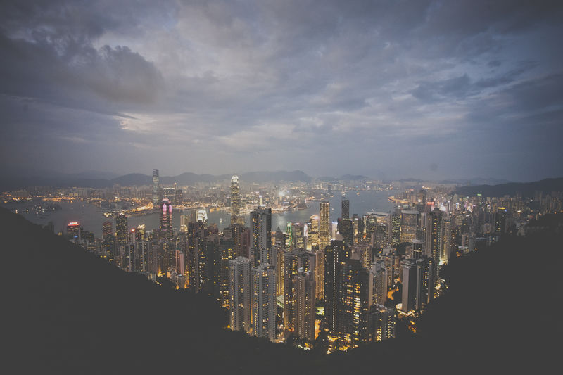 the illuminated view from Victoria's Peak in Hong Kong Aerial View Architecture Building Exterior Built Structure City City Life Cityscape Cloud - Sky Crowded Financial District  Hong Kong Illuminated Modern Night Office Building Outdoors Sky Skyscraper Tall - High Tower Urban Skyline Victoria's Peak Water Wide Wide Shot