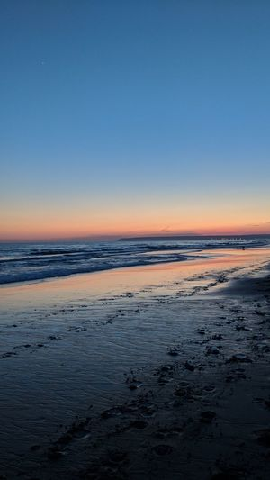 Sunset Blue Orange Color Water Beach Sand Foodsteps Reflection