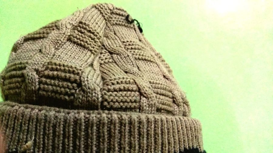 Close-up of hat against gray background