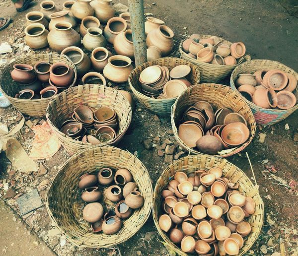 High angle view of wicker basket full of pots for sale at market