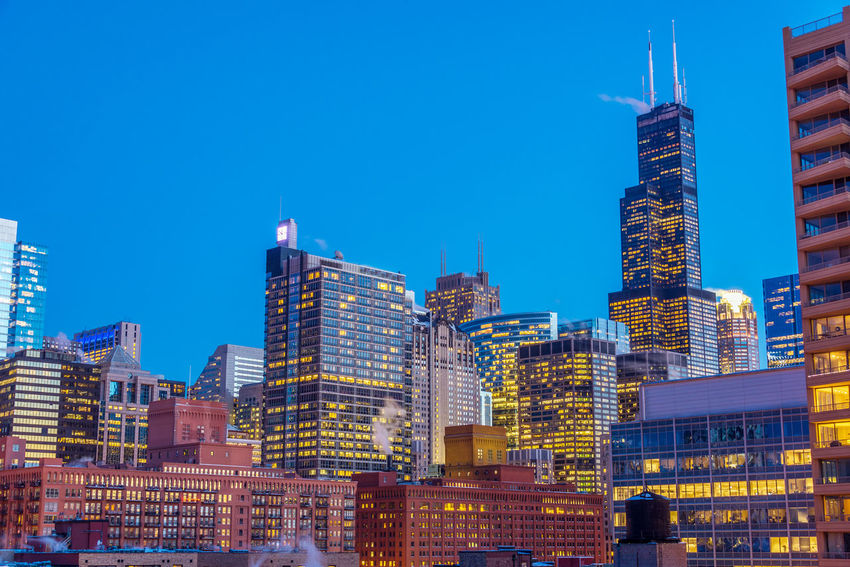 View of downtown Chicago taken during the blue hour Architecture Blue Building Building Exterior Chicago City Cityscape Cityscapes Colorful Destination Destinations Downtown Evening Horizon Illinois Landmark Modern Office Outdoors Panoramic Scene Sears Sky Tower Travel Destinations