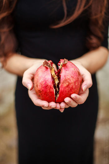 Close-up of woman holding pomegranate