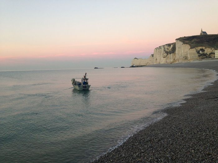 Beauty In Nature Beauty In Nature Boat Calm Church Etretat Cliffs Falaise De Normandie Horizon Over Water Nature Normandy Beach Ocean Outdoors Plage Sail Away Sea Sky Over Horizon Stone Beach Sunset Tranquility Water étretat