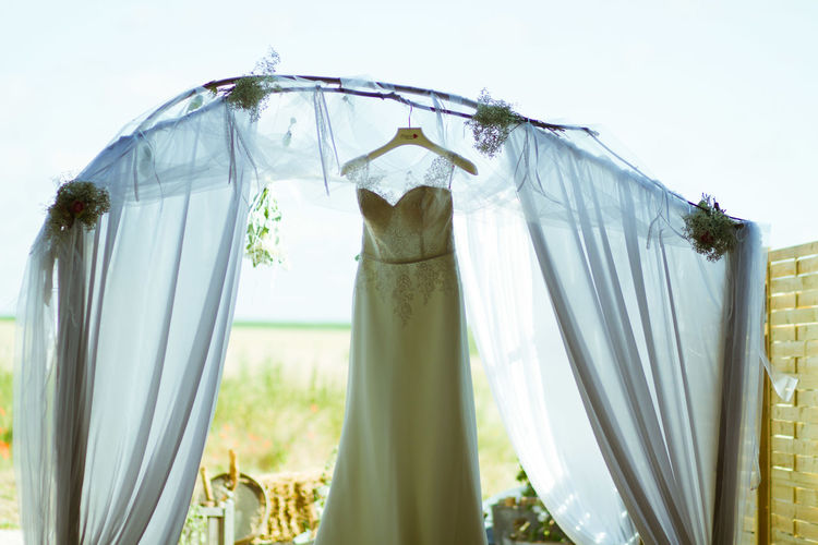 Wedding Photography Bed Boda Country Clean Clothesline Clothing Coathanger Curtain Day Domestic Life Drying Hanging Laundry Linen Nature No People Outdoors Sheet Textile Vestido De Novia Washing Wedding Dress White Color Window