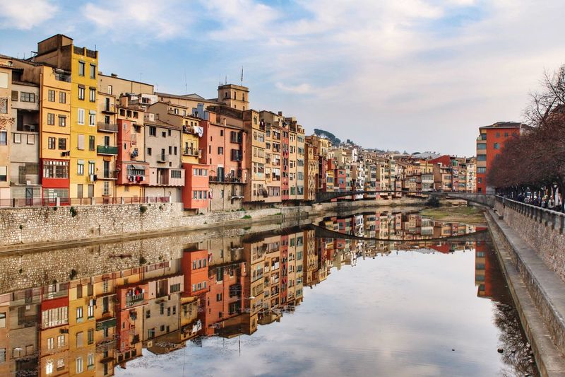Girona, Spain SPAIN Girona EyeEmNewHere Building Exterior Water Reflection Architecture Built Structure Sky Building Cloud - Sky Waterfront City Canal House Row House Outdoors Town