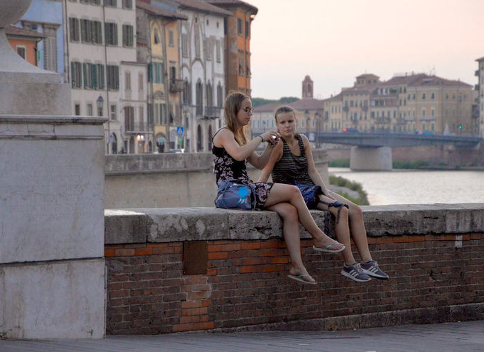 Arno  Lucca Italy Pont Architecture Building Exterior Built Structure Casual Clothing City Eyemphotography Lifestyles Nature People Real People Water Young Adult Young Women