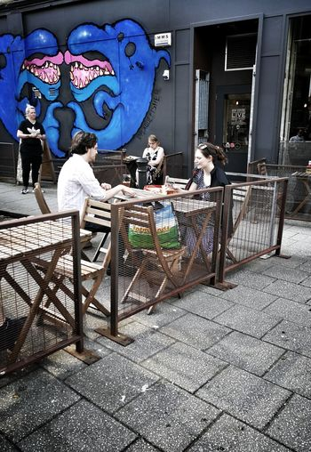 Bar Outdoor Seating Area Streetphotography Bus Stop, Candid Photography P10 Plus Photography Building Exterior Built Structure Street Art Alcoholic Drink Beer Mural Fresco