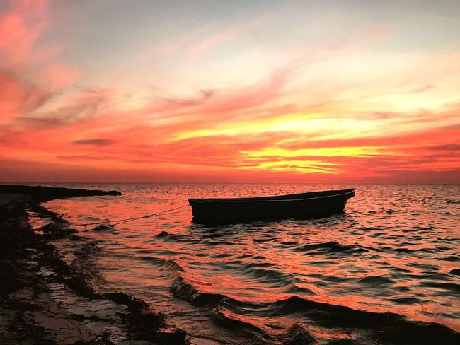 Sunset in a little place in Mexico Sunset Beauty In Nature Water Sea Orange Color Horizon Over Water Tranquility Tranquil Scene No People Cloud - Sky Beach Outdoors Scenics The Great Outdoors - 2017 EyeEm Awards Breathing Space