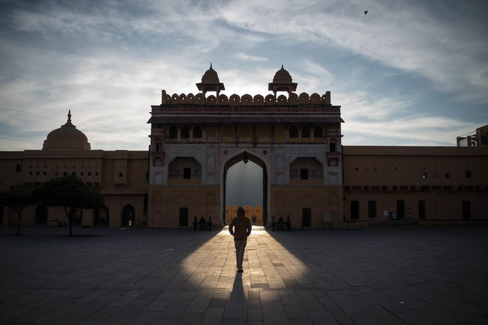 A man walking towards an entrance lit up by the morning sun light. ASIA Architecture Entrance India Jaipur Morning Light Roof First Eyeem Photo First Light Fort Palace People Rajasthan Street Photography Sunrise EyeEmNewHere