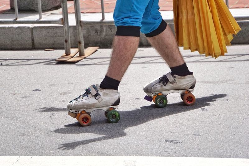 Low Section Of Man Skating On Road