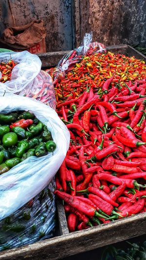High angle view of red chili peppers for sale at market stall