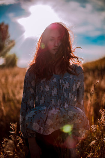 Cochrane, Alberta EyeEmNewHere Beautiful Woman Beauty In Nature Casual Clothing Day Field Full Length Leisure Activity Lifestyles Long Hair Medium-length Hair Nature One Person Outdoors People Portrait Real People Sky Standing Sunlight Sunset Women Young Adult Young Women