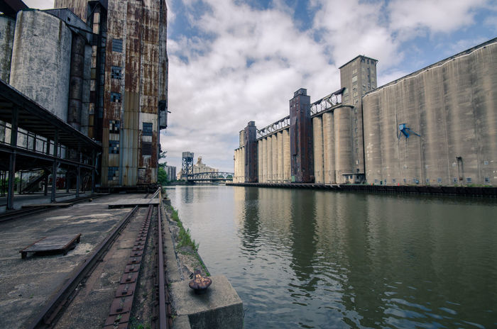 Architecture Bu Building Building Exterior Built Structure Canal City City Life Cloud Cloud - Sky Cloudy Day Diminishing Perspective Grain Elevator Historic Nature No People Outdoors Rippled River Sky The Way Forward Travel Destinations Water