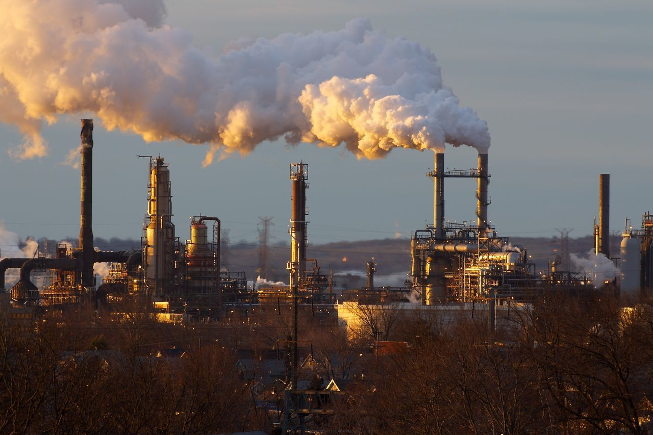 industry, pollution, smoke stack, smoke - physical structure, factory, air pollution, fumes, emitting, chemical, chimney, environment, manufacturing, environmental issues, tall, fuel and power generation, complexity, no people, built structure, steam, oil industry, clear sky, sky, outdoors, day, petrochemical plant