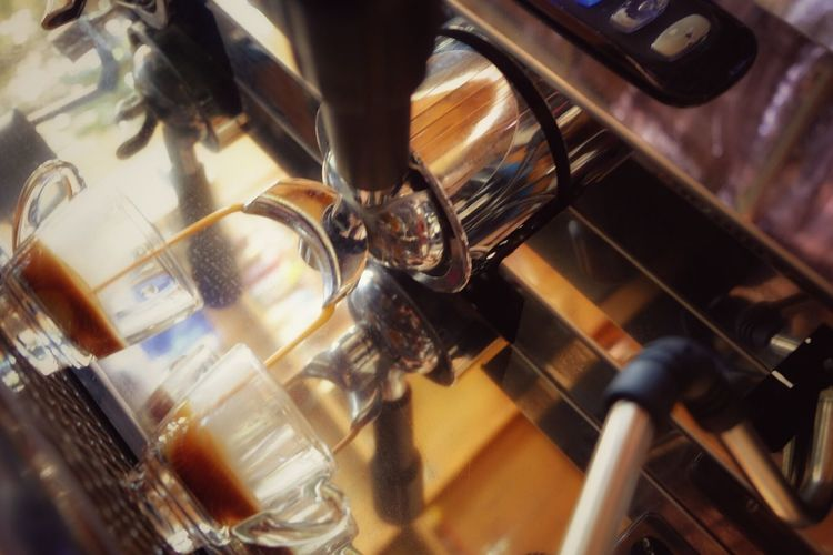 Tilt image of coffee being poured from espresso maker