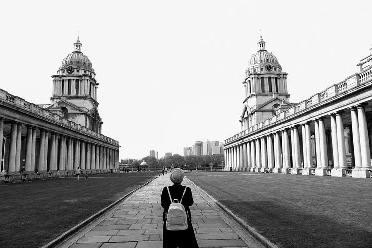 Rear View Of Person Standing Footpath At Royal Navy College
