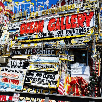 Alot of art work on the board walk in ocean city md. Text For Sale Communication Day Outdoors No People Multi Colored Architecture Close-up