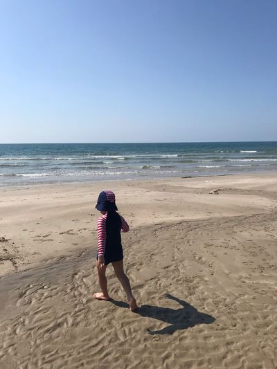 Sea Beach Water Sky Land Horizon Over Water Horizon One Person Full Length Nature Leisure Activity Clear Sky Real People Tranquil Scene Scenics - Nature Beauty In Nature Sand Rear View Tranquility Outdoors