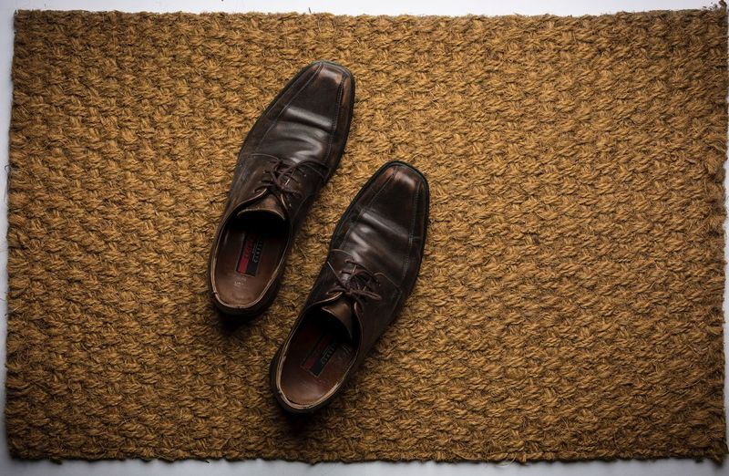 Close-up of shoes on doormat