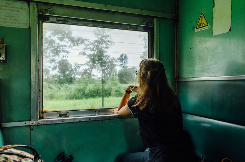 Woman sitting in glass window
