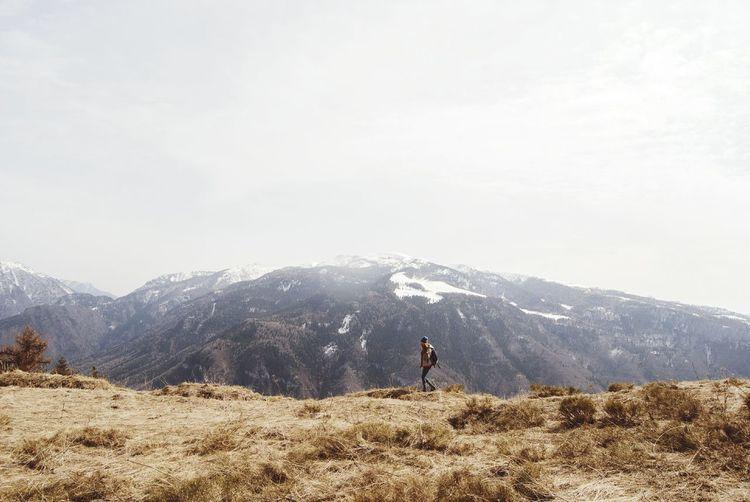 Woman hiking at monte finonchio peak against sky