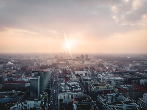 DJI X Eyeem From Above  Hope Spirituality Aerial View Architecture Atmospheric Mood Built Structure City Cityscape Day Dronephotography High Angle View Lens Flare Office Building Exterior Progress Residential District Sun Sun Flare Sunbeam Sunlight Sunrise Sunset Warm Light