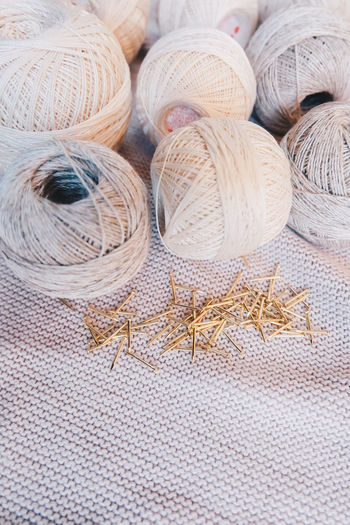 Textile Still Life No People Close-up Art And Craft Craft Pattern Wool Creativity Full Frame Ball Of Wool Indoors  Backgrounds Choice Material Variation Group Of Objects Clothing Day Jute Softness Neutral Colors Yarn Yarn Balls Cotton Cotton Balls Strings